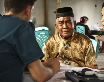 Adam works with patient in Likupang